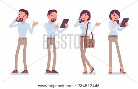 Smart Middle Aged Man And Woman In Buttoned Up Shirt, Camel Skinny Chino Trousers, Standing With Gad