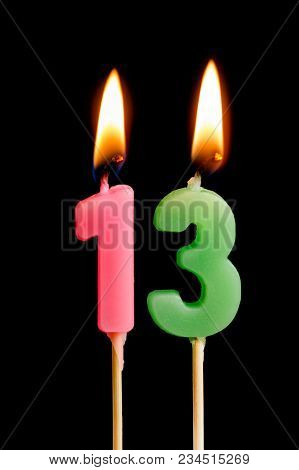 Burning Candles In The Form Of 13 Thirteen Figures (numbers, Dates) For Cake Isolated On Black Backg