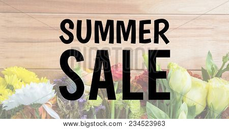 Black summer sale text against faded image of flowers on table