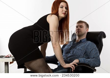 Sexy Secretary Flirting With Boss In The Workplace. Sexual Harassment And Office Abuse Concept.