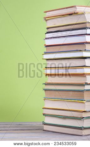 Book Stacking. Open Hardback Books On Wooden Table And Green Background. Back To School. Copy Space