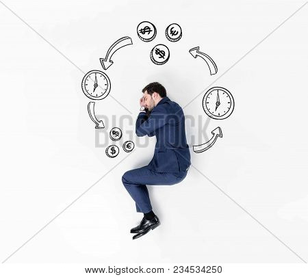 Creative Collage Of Young Businessman Sleeping In Suit In Money And Time Chain