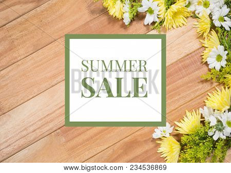 Overhead of flower on table with green and white summer sale graphic