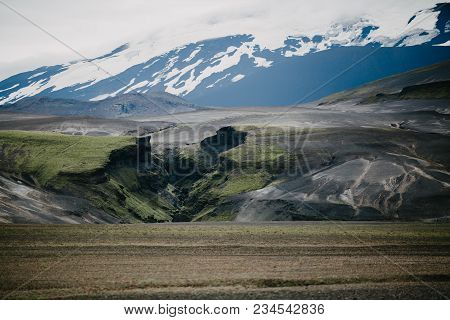 Majestic Landscape With Snow-covered Mountains, Magnificent Natural Formations And Green Vegetation