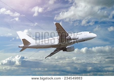 Commercial Airplane. Airplane Flying In The Sky, Travel Background With Commercial Flying White Airp