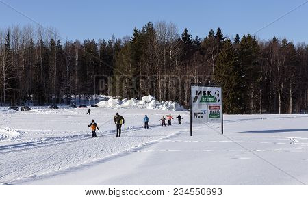 Umea, Sweden On February 22. View Of Same Very Young And Unidentified Cross-country Skier, A Commerc