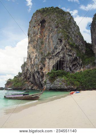 Vertical Shot Of Blue Water Boats And Mountain On Phra Nang Beach Railay Krabi Province Thailand