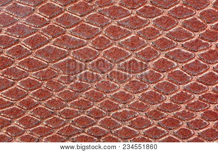 Background Of Scales Similar To Snakeskin In Gold Brown Color