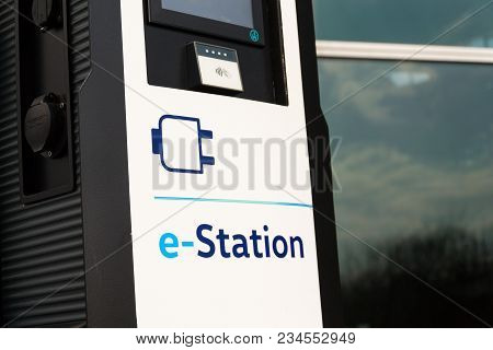 Dresden, Germany - April 2 2018: Electric Car Charging Station In Front Of The Volkswagen Glaserne M