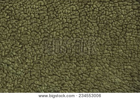 Artificial Vintage Fur. Yellow Fur Pattern Background. Macro Material.