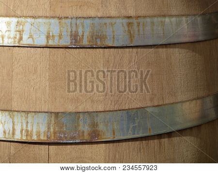 Closeup Of Wooden Barrel With Metal Hoops. Wine Barrel With Rusty Iron Rings