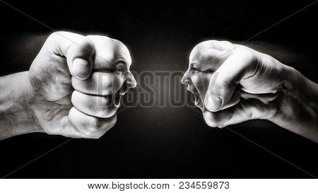 Two Fists With A Male And Female Face Collide With Each Other On Dark Background. Concept Of Confron