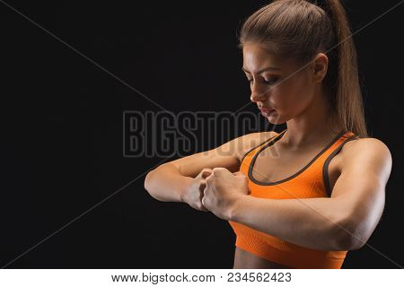 Calm Female Fighter Ready To Fight Over Black Background. Kickboxing And Fight Sport Concept. Studio