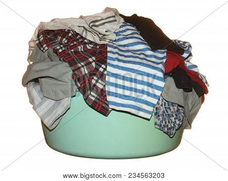 Various Clothes In A Basin Prepared For Washing Isolated On A White Background.