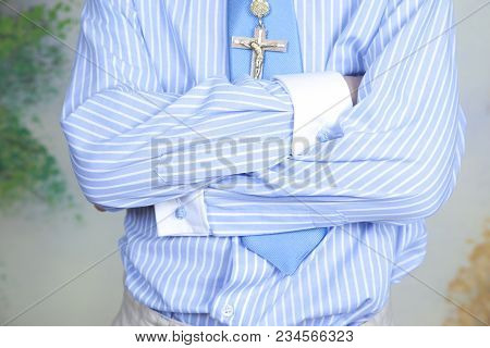 Detail Of The Shirt With Stripes In Blue And White And Blue Sky Tie Of A Communion Child, Who Has A