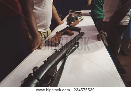 Arms Trafficking. Different Rifles On The Counter In The Gun Shop. Clandestine Sale Of Weapons. Ille