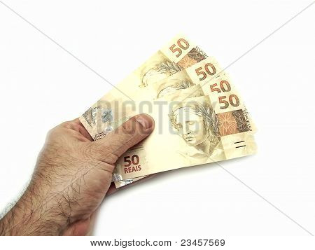 Hand Holding New Design Currency From Brazil