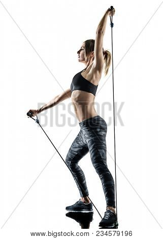 one caucasian woman exercising pilates fitness elastic resistant band exercises isolated silhouette on white background poster