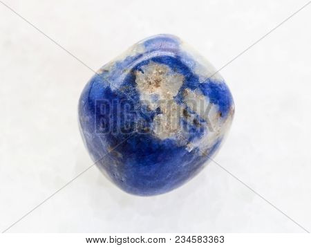 Macro Shooting Of Natural Mineral Rock Specimen - Polished Sodalite Gemstone On White Marble Backgro