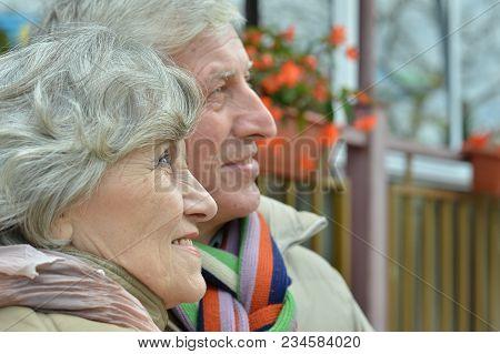 Portrait Of Beautiful Caucasian Senior Couple Looking Away
