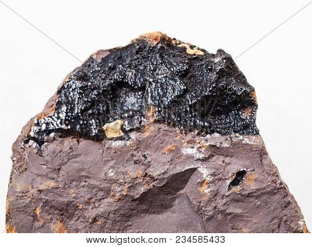 Macro Shooting Of Natural Mineral Rock Specimen - Goethite Ore On Limonite Stone On White Marble Bac