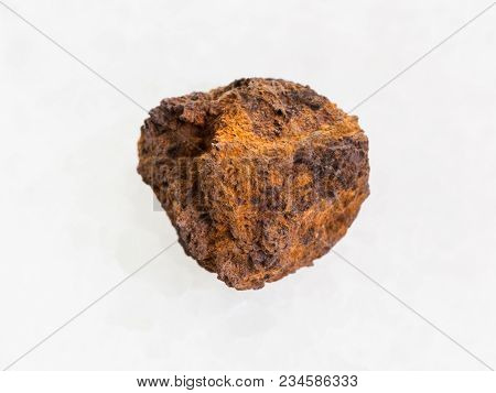 Macro Shooting Of Natural Mineral Rock Specimen - Rough Limonite (iron Ore) Stone On White Marble Ba