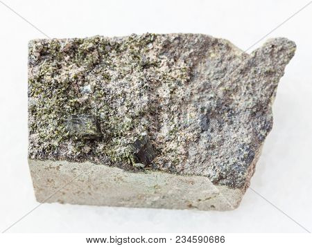 Macro Shooting Of Natural Mineral Stone Specimen - Raw Green Crystals Of Epidote On Rock On White Ma