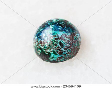 Macro Shooting Of Natural Mineral Rock Specimen - Ball From Chrysocolla Gemstone On White Marble Bac