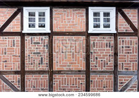 Old Half-timbered Facade With Windows. Detail Of Half-timbered Facade