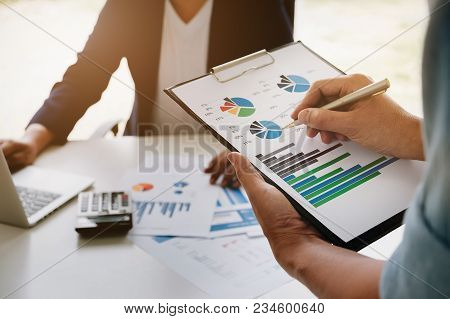 Business Financial Concept,consult Partner Hand Holding Pen Point Stock Marketing Document And Busin