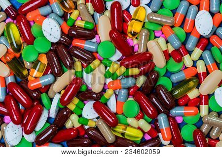 Full Frame Of Colorful Tablets And Capsules Pills. Antibiotic Resistance And Drug Use With Reasonabl
