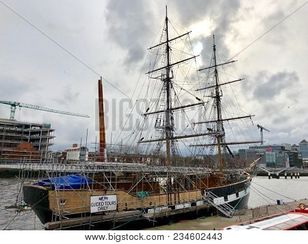 DUBLIN, IRELAND - APRIL 1, 2018: A replica of the Jeanie Johnston, a 19th-century tall ship that took Irish emigrants to America, on the River Liffey in Dublin, Ireland.