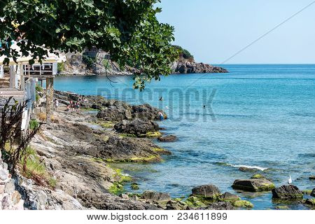 Sozopol, Bulgaria - August 24, 2017: View On The Rocky Shore Of The Sozopol In The Ancient Seaside T