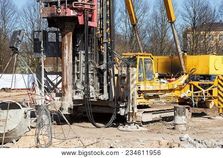Pile Bore Machine. A Pile Driver Is A Mechanical Device Used To Drive Piles, Poles Into Soil To Prov