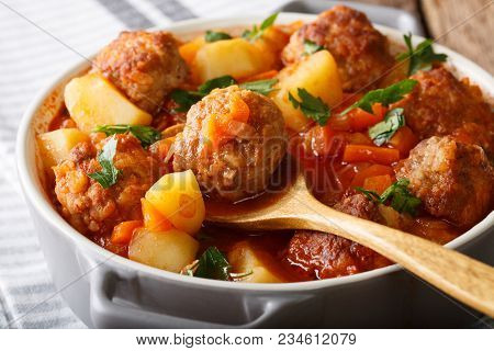 Meatballs Stewed With Vegetables In A Tomato Sauce Close-up In A Pot. Horizontal