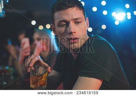Portrait Of Weary Bibacious Man Drinking Glass Of Whiskey. He Resting In Bar. Fatigue And Leisure Co
