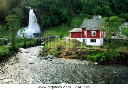 A Waterfall Scene In Hardanger Norway