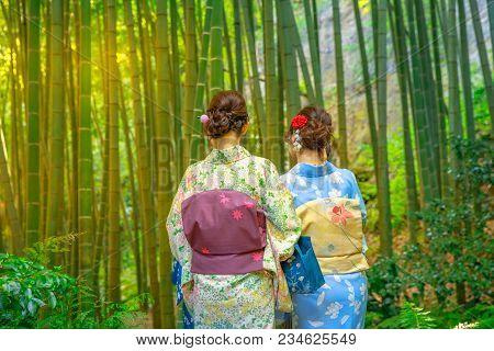 Kamakura, Japan - April 23, 2017: Women Wearing Japanese Kimono Walking In Bamboo Garden Of Take-der