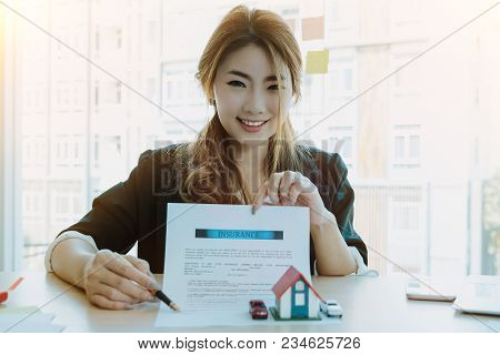 Portrait Of Attractive Asian Real Estate Cheerful To Sign Home Insurance - Business Real Estste Conc
