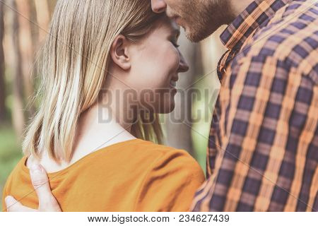 Enjoyed Girl Standing With Eyes Closed While His Boyfriend Hugging Her With Tenderness