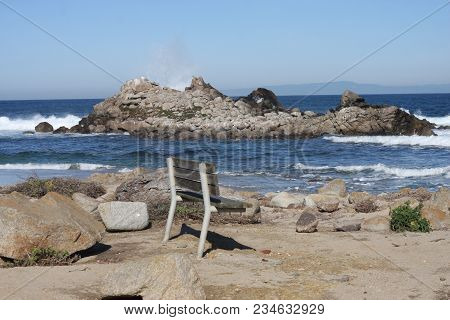 This Is An Image Of A Bench Along The Shoreline Of Pacific Grove, California.