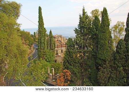 The Road Serpentine. Mountain Winding Road In The City Of Taormina. Red Bus. The Island Of Sicily, I