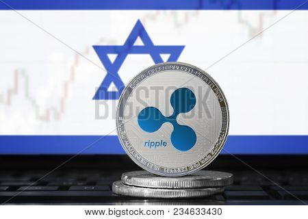 Ripple (xrp) Cryptocurrency; Physical Concept Ripple Coin On The Background Of The Flag Of Israel