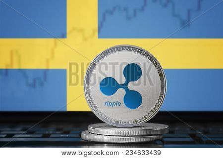 Ripple (xrp) Cryptocurrency; Physical Concept Ripple Coin On The Background Of The Flag Of Sweden (k