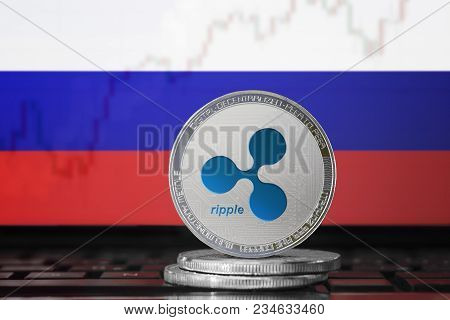 Ripple (xrp) Cryptocurrency; Physical Concept Ripple Coin On The Background Of The Flag Of Russia (r