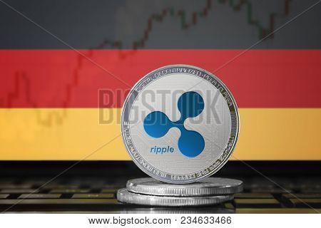 Ripple (xrp) Cryptocurrency; Physical Concept Ripple Coin On The Background Of The Flag Of Germany