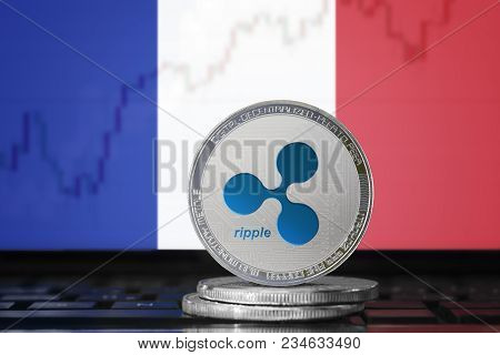 Ripple (xrp) Cryptocurrency; Physical Concept Ripple Coin On The Background Of The Flag Of France (f