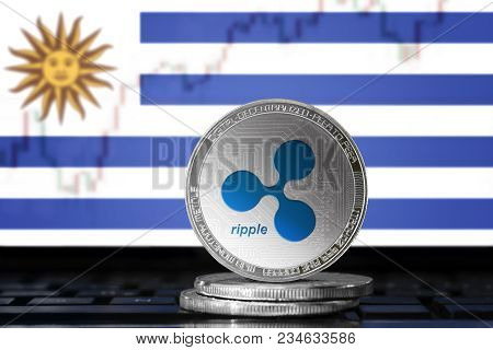 Ripple (xrp) Cryptocurrency; Physical Concept Ripple Coin On The Background Of The Flag Of Uruguay