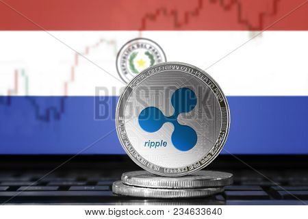 Ripple (xrp) Cryptocurrency; Physical Concept Ripple Coin On The Background Of The Flag Of Paraguay