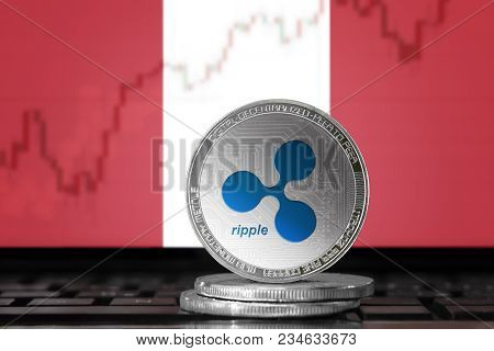 Ripple (xrp) Cryptocurrency; Physical Concept Ripple Coin On The Background Of The Flag Of Peru